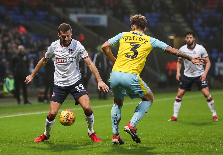 Bolton Wanderers' Gary O'Neil competing with Rotherham United's Joe Mattock<br /> <br /> Photographer Andrew Kearns/CameraSport<br /> <br /> The EFL Sky Bet Championship - Bolton Wanderers v Rotherham United - Wednesday 26th December 2018 - University of Bolton Stadium - Bolton<br /> <br /> World Copyright © 2018 CameraSport. All rights reserved. 43 Linden Ave. Countesthorpe. Leicester. England. LE8 5PG - Tel: +44 (0) 116 277 4147 - admin@camerasport.com - www.camerasport.com