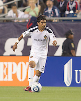 Los Angeles Galaxy defender A.J. DeLaGarza (20) dribbles down the wing. In a Major League Soccer (MLS) match, the Los Angeles Galaxy defeated the New England Revolution, 1-0, at Gillette Stadium on May 28, 2011.