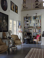 Portrait of designer Lars Bolander pictured In the living room where a double-height ceiling and the cool colour-scheme of white and grey have created a Scandanvian oasis in the hot sun of Florida
