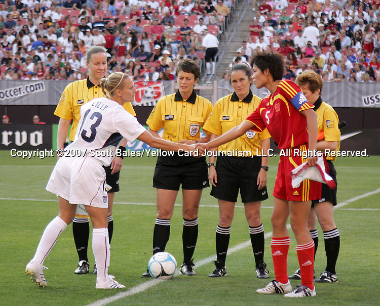 16 June 2007: Captains Kristine Lilly (USA, 13) and Li Jie (China, 5) shake hands at midfield, pregame. The United States Women's National Team defeated the Women's National Team of China 2-0 at Cleveland Browns Stadium in Cleveland, Ohio in an international friendly game.