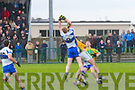 A great catch by Desmond's Pat Fitzgerald beating Finuge's John McCarthy to the ball.