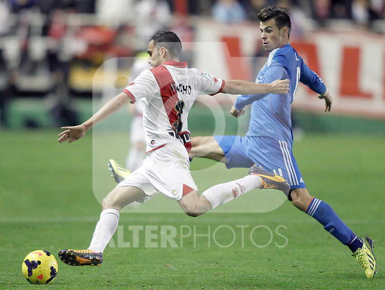 Rayo Vallecano's Nacho Garcia (l) and Real Madrid's Garet Bale during La Liga match.November 22,2013. (ALTERPHOTOS/Acero)