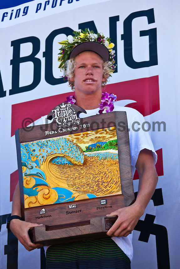 BANZAI PIPELINE, Oahu/Hawaii (Saturday, December 10, 2011) – Kieren Perrow (AUS), 34, has won his inaugural ASP World Tour event, taking out the Billabong Pipe Masters in Memory of Andy Irons over fellow countrymen Joel Parkinson (AUS), 30, in four-to-six foot waves. John John Florence (HAW), 19, also found his way to the podium as the overall winner of the 2011 Vans Triple Crown...Perrow, who finished runner-up to Jeremy Flores (FRA), 23, in last year's Billabong Pipe Masters, returned to form again this year and charged the massive Pipeline conditions on the opening two days of competition to solidify his position on the 2012 ASP World Tour. The Australian was equally deadly in the smaller conditions on the final day and commanded the Final against Parkinson in a backdoor shootout to secure his maiden ASP World Tour victory...John John Florence put on an amazing show at this year's Billabong Pipe Masters, taking the event's only two perfect 10-point rides,  but fell to Slater in the Quarterfinals. Florence's overall effort including a win at the Vans World Cup of Surfing at Sunset Beach and a 5th place at the Reef Hawaiian Pro secured his first Vans Triple Crown win, making him the youngest competitor in history to win the prestigious series.  Photo: joliphotos.com