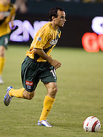 Landon Donovan dribbles the ball in the US Open Cup at the Home Depot Center, in Carson, Calif., Wednesday, September 28, 2005.