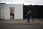 A home supporter arriving at the turnstiles at Borough Briggs, home to Elgin City, on the day they played SPFL2 newcomers Edinburgh City. Elgin City were a former Highland League club who were elected to the Scottish League in 2000, whereas Edinburgh City became the first club to gain promotion to the League by winning the Lowland League title and subsequent play-off matches in 2015-16. This match, Edinburgh City's first away Scottish League match since 1949, ended in a 3-0 defeat, watched by a crowd of 610.