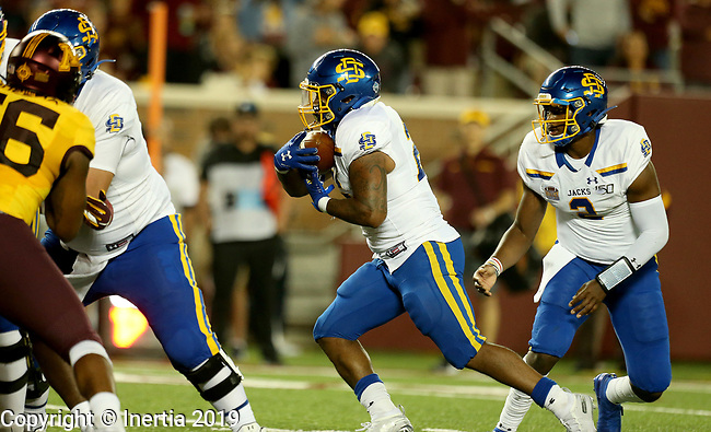 MINNEAPOLIS, MN - AUGUST 29: Mikey Daniel #26 from South Dakota State University takes the handoff from J'Bore Gibbs #2 en route for a touchdown against the University of Minnesota during their game Thursday night at TCF Bank Stadium in Minneapolis, MN. (Photo by Dave Eggen/Inertia)