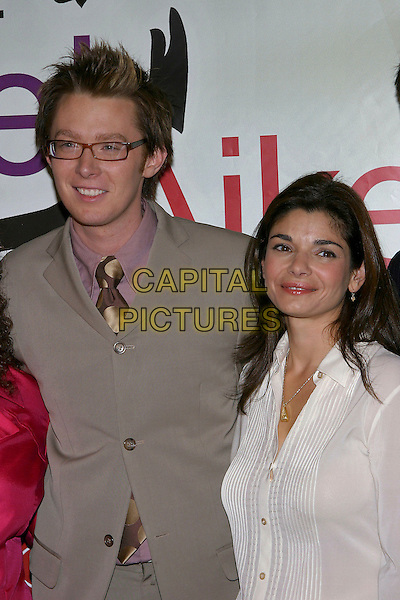 CLAY AIKEN & LAURA SAN GIACOMO.Bubel/Aiken Foundation's Voices for Change Gala  held at the Century Plaza Hotel, Century City, California , USA,.19th November 2004..half length.Ref: ADM.www.capitalpictures.com.sales@capitalpictures.com.©Capital Pictures.