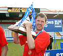 Scott Laird of Stevenage Borough celebrates with the Blue Square Premier championship trophy after the Blue Square Premier match between Stevenage Borough and York City at the Lamex Stadium, Broadhall Way, Stevenage on Saturday 24th April, 2010..© Kevin Coleman 2010 ..