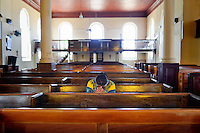 Worshipper in the Falmouth Parish Church of St. Peter the Apostle. The oldest public building in Falmouth. Maxine. Jamaica Tourism.