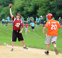 First baseman Dan Gallagher (left) catches the ball to force out Dan Lehner at fist base during the Miracle League Festival, a softball tournament for players with intellectual and physical challenges at George School Saturday June 20, 2015 in Newtown, Pennsylvania. (Photo by William Thomas Cain)