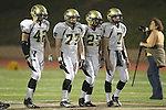 Torrance, CA 11/05/10 - Haden Gregory (Peninsula #42), Blake Allman (Peninsula #77), Logan Okuda (Peninsula #25) and Brock Dale (Peninsula #7) in action during the Peninsula vs West varsity football game played at West Torrance high school.