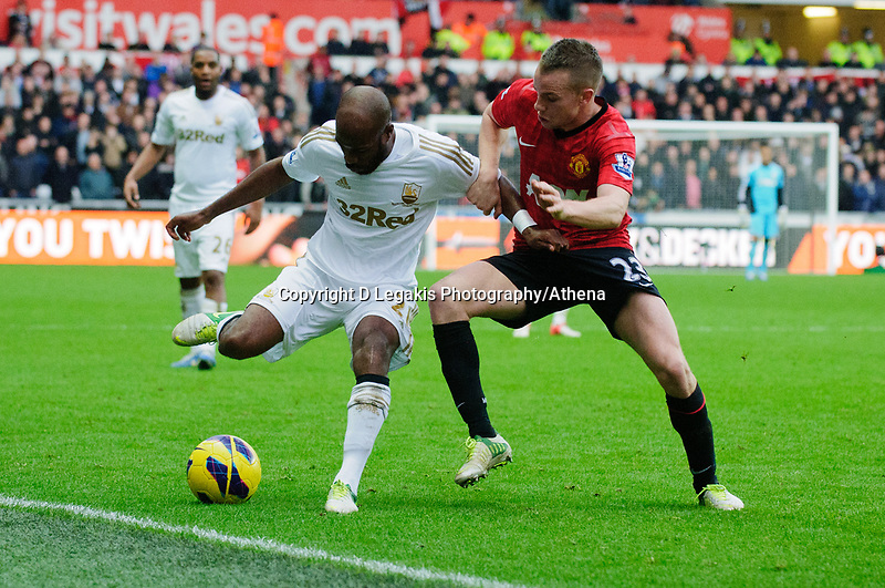Sunday, 23 November 2012<br /> <br /> Pictured: Dwight Tiendalli of Swansea City and Tom Cleverley of Manchester United<br /> <br /> Re: Barclays Premier League, Swansea City FC v Manchester United at the Liberty Stadium, south Wales.
