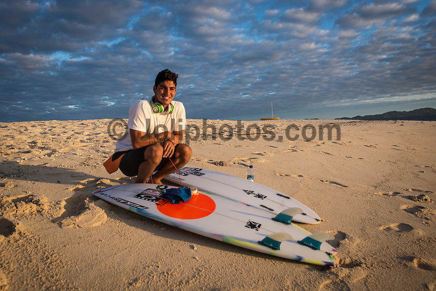 Namotu Island Resort, Namotu, Fiji. (Thursday June 5, 2014) Gabriel Medina (BRA) leaving the beach this monring at first light and heading out to Cloudbreak for the finals. &ndash; The 2014 Fiji Pro was won by Gabriel Medina (BRA) this morning after defeating USA's Nat Young (USA) in the 40 minute final. Medina had defeated Kolohe Andino (USA) in the first semi final and Young had defeated Michel Bourez (PYF) in their semi final.<br /> Medina moved to  the top of the WCT ratings with his win. Photo: joliphotos.com