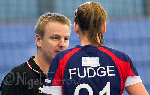 22 OCT 2011 - LONDON, GBR - British Head Coach, Jesper Holmris (left), talks with Britain's Kathryn Fudge before the Women's 2012 European Handball Championship qualification match against Russia at the National Sports Centre at Crystal Palace .(PHOTO (C) NIGEL FARROW)