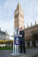 PICTURE BY ALEX BROADWAY/SWPIX.COM - Rugby League - RLWC2013 - Rugby League World Cup Parliament Visit - Westminster, London, England  - 31/10/12 - MP's have their photograph taken with the Rugby League World Cup outside the Houses of Parliament. Gerry Sutcliffe.