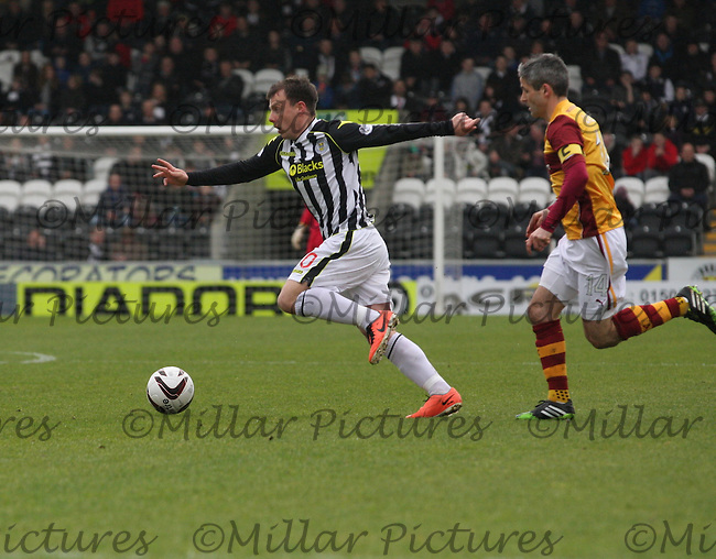 Paul McGowan gets away from Keith Lasley in the St Mirren v Motherwell Scottish Professional Football League Premiership match played at St Mirren Park, Paisley on 5.4.14.
