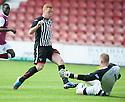 Arbroath keeper Scott Morrison saves at the feet of Pars' Ryan Thomson.