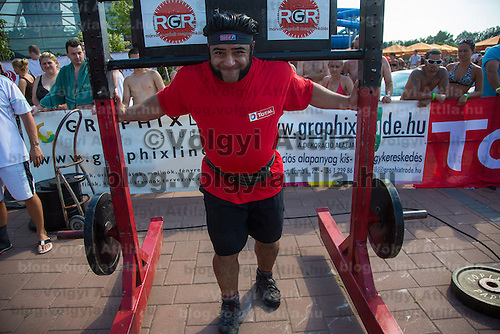 Patrik Baboumian of Germany competes in yoke carry during the Giants Live Strongman Competition in Budapest, Hungary on June 17, 2012. ATTILA VOLGYI