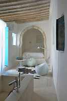 Room No 3 in this charming Tunisian hotel is long and thin with a double bed tucked into an arched alcove and a concrete tadelakt bath in the centre of the room concealed behind a simple curtain of metal beads