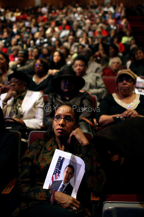 Keiana Barrett , 36, Director of Development for DuSable, from Chicago, watches the inauguration of Barack Obama as President of the United States in the theater of the DuSable Museum of African-American History in Chicago, Illinois, on the Presidential Inauguration Day, Tuesday, January 20, 2009.  (Photo by Yana Paskova for The New York Times)..Assignment ID: 30075164A