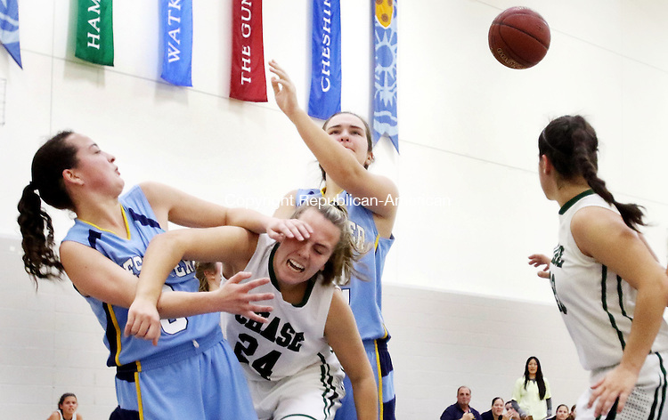 MIDDLEBURY CT. 16 January 2015-011616SV19-#3 Zulie Dunn of Westover School and #24 Maddy Jensen of Chase Collegiate School collide while going for the rebound during basketball action in Middlebury Saturday. <br /> Steven Valenti Republican-American