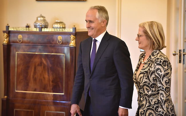 Australian Prime Minister Malcolm Turnbull (L) arrives with his wife Lucy (R) at Government House, Canberra on September 15, 2015. Photographer: Mark Graham/Bloomberg