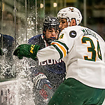 20 January 2017: University of Connecticut Husky Forward Corey Ronan, a Junior from Franklin, MA, is checked on the boards by University of Vermont Catamount Defenseman Jake Massie, a Freshman from St. Lazare, Quebec, during first period action at Gutterson Fieldhouse in Burlington, Vermont. The Huskies fell to the Catamounts 5-4 in the first game of their Home-and-Home Hockey East Series. Mandatory Credit: Ed Wolfstein Photo *** RAW (NEF) Image File Available ***