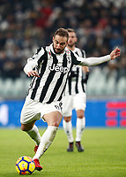 Calcio, Serie A: Juventus - Genoa, Torino, Allianz Stadium, 22 gennaio 2018. <br /> Juventus Gonzalo Higuain in action during the Italian Serie A football match between Juventus and Genoa at Torino's Allianz stadium, January 22, 2018.<br /> UPDATE IMAGES PRESS/Isabella Bonotto