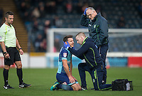 Matt Bloomfield of Wycombe Wanderers receives treatment from Wycombe Wanderers Physiotherapist Cian O'Doherty during the Sky Bet League 2 match between Wycombe Wanderers and Hartlepool United at Adams Park, High Wycombe, England on 26 November 2016. Photo by Andy Rowland / PRiME Media Images.
