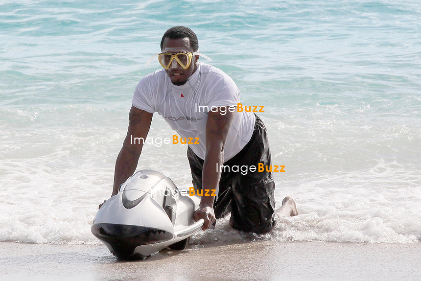 P. DIDDY IN SAINT BARTHS - When you're as loaded as P. Diddy, you don't use your average boogie board while in the ocean. Instead, the media mogul cruised through the surf in St. Barth using a motorized devIce..The rapper and his family have been enjoying the luxe location aboard a yacht named The Oasis. The multi-million dollar vessel houses up to 12 guests in five guest cabins and a master suite with its own jacuzzi..And a deck converts into an open-air dance floor..December 27, 2012..