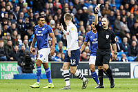 Paul Gallagher of Preston North End (C) sees a yellow card by referee Jeremy Simpson during the Sky Bet Championship match between Cardiff City and Preston North End at the Cardiff City Stadium, Wales, UK. Saturday 21 December 2019