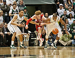 Wisconsin Badgers forward Mike Bruesewitz battles for a loose ball with Michigan State Spartans Denzel Valentine (45) and Adreian Payne during a Big Ten basketball game at the Breslin Center in East Lansing, MI on March 7, 2013. (Photo by Bob Campbell)