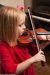Education elementary Kindergarten music enrichment female student playing violin in private music lesson