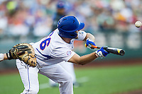 Florida Gators outfielder Ryan Larson (66) squares to bunt against the Miami Hurricanes in the NCAA College World Series on June 13, 2015 at TD Ameritrade Park in Omaha, Nebraska. Florida defeated Miami 15-3. (Andrew Woolley/Four Seam Images)