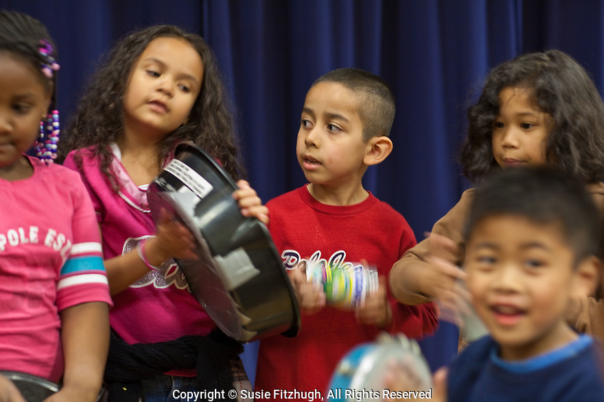 Eduardo Mendonca, with Luc Reynaud's help, teaches Brazilian Rhythms to elementary school students at Northgate WS in Seattle.