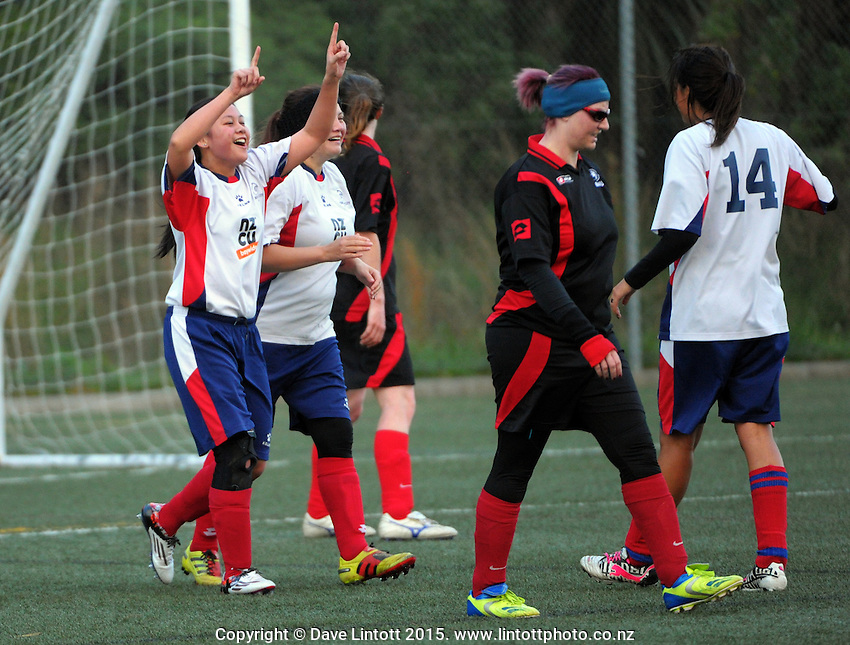 Action from the women's Capital Football club match between Brooklyn Northern United (red and black) and Porirua (white, red and blue) at Wakefield Park, Wellington, New Zealand on Sunday, 31 May 2015. Photo: Dave Lintott / lintottphoto.co.nz