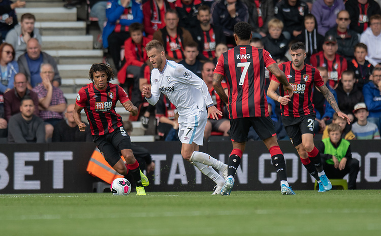 West Ham United's Andriy Yarmolenko (right) battles with Bournemouth's Nathan Ake (left) on his way to scoring his side's first goal.<br /> <br /> Photographer David Horton/CameraSport<br /> <br /> The Premier League - Bournemouth v West Ham United - Saturday 28th September 2019 - Vitality Stadium - Bournemouth<br /> <br /> World Copyright © 2019 CameraSport. All rights reserved. 43 Linden Ave. Countesthorpe. Leicester. England. LE8 5PG - Tel: +44 (0) 116 277 4147 - admin@camerasport.com - www.camerasport.com