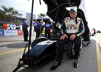 Apr. 5, 2013; Las Vegas, NV, USA: (Editors note: Special effects lens used in creation of this image) NHRA funny car driver John Force during qualifying for the Summitracing.com Nationals at the Strip at Las Vegas Motor Speedway. Mandatory Credit: Mark J. Rebilas-