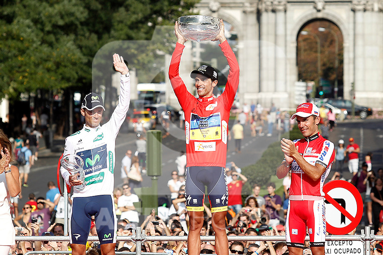 Alberto Contador, first classified (c), Alejandro Valverde, second classified (l) and Joaquin Purito Rodriguez, third classified in the podium of of La Vuelta 2012.September 9,2012. (ALTERPHOTOS/Acero)