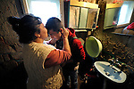Bajram Kruezi's mother, Sabahata, kisses him as he prepares to leave home in the morning in the Zemun Polje neighborhood of Belgrade, Serbia, on his way to the Branko Pesic School, an educational center for Roma children and families which is supported by Church World Service. Kruezi's family came to Belgrade as refugees from Kosovo, and like many Roma can't afford regular school fees. Many Roma also lack legal status in Serbia, and thus have difficulty obtaining formal employment and accessing government services. Kruezi wants to be a Muslim religious scholar when he grows up.