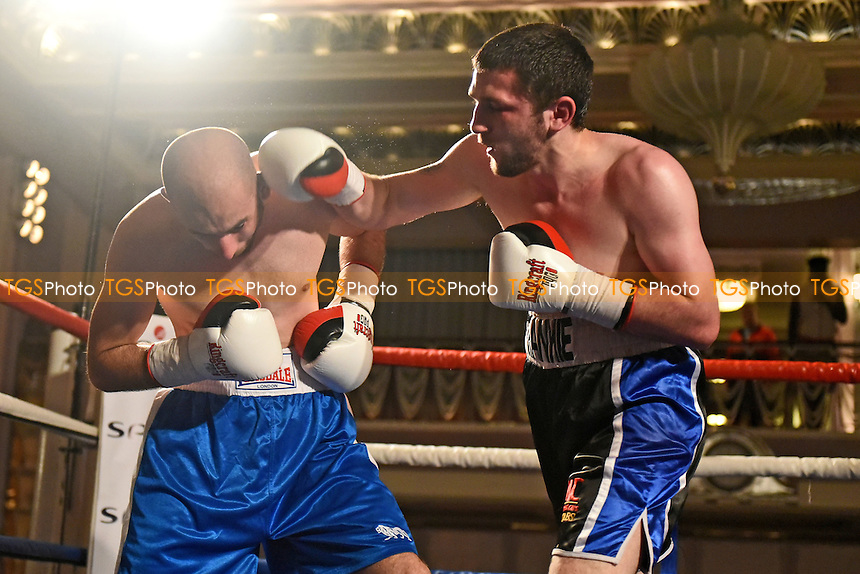 Danny Parsons (black/blue shorts) defeats Lukas Leskovic during a Boxing Show at Park Lane Hotel on 26th May 2016