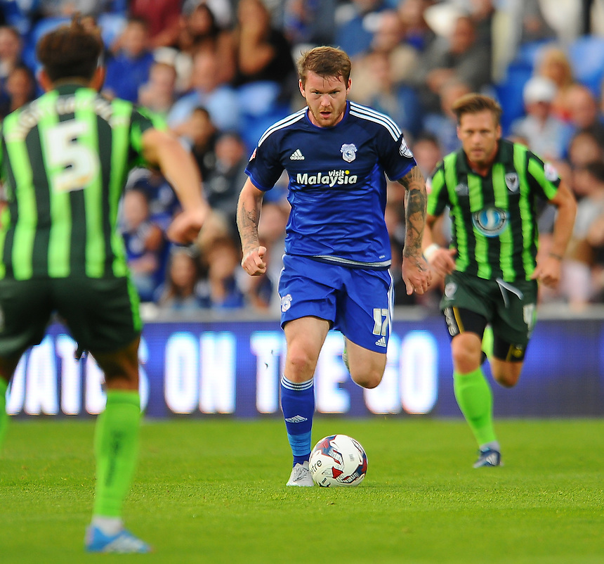 Cardiff City's Aron Gunnarsson in action during todays match  <br /> <br /> Photographer Craig Thomas/CameraSport<br /> <br /> Football - Capital One Cup First Round - Cardiff City v AFC Wimbledon - Tuesday 11th August 2015 - Cardiff City Stadium - Cardiff <br /> &copy; CameraSport - 43 Linden Ave. Countesthorpe. Leicester. England. LE8 5PG - Tel: +44 (0) 116 277 4147 - admin@camerasport.com - www.camerasport.com