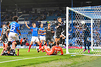 Wes Harding of Birmingham City right fails to clear the header from Ellis Harrison of Portsmouth left for the first goald during Portsmouth vs Birmingham City, Caraboa Cup Football at Fratton Park on 6th August 2019