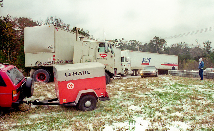 The scene of a wreck, one of several along I-10, after a heavy snow and ice storm two days before Christmas 1989.  The December 23rd snow accumulated enough to cause traffic issues and build snow men.