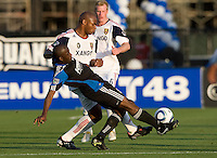 Jamison Olave of Real Salt Lake fights for the ball against Cornell Glen of Earthquakes during the game at Buck Shaw Stadium in Santa Clara, California on March 27th, 2010.   Real Salt Lake defeated San Jose Earthquakes, 3-0.