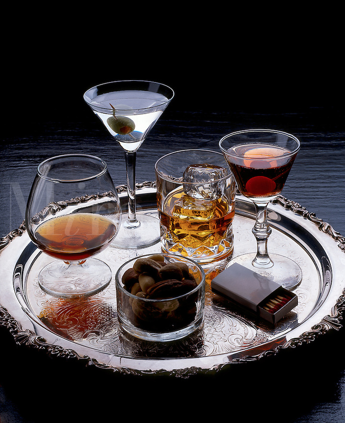 Cocktails on a silver serving tray.