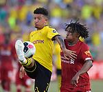Football: Test Match, Liverpool FC - Borussia Dortmund. Borussia Dortmund midfielder Jadon Sancho (7, left) and Liverpool midfielder Yasser Larouci (65) vie for the ball in their exhibition match on July 19, 2019 at Notre Dame Stadium. <br /> Tim Vizer/DPA