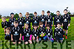The Iveragh Eagles RFC Rugby side who hosted the West Munster Mini Blitz at the OTW Sports Centre in Cahersiveen on Saturday pictured here front l-r; Alex O'Driscoll, Fionán Foley, Lilly May Donnelly, Colm O'Sullivan, Killian O'Connell, Alex Nassar, Rohan O'Sullivan, back l-r; Finn O'Neill, Fionán Brain, Jack Coffey, Cian O'Shea, Joe O'Mahony, Sean Griffin, Adam Nassar, Conor Lyne & Óisín Devereux.