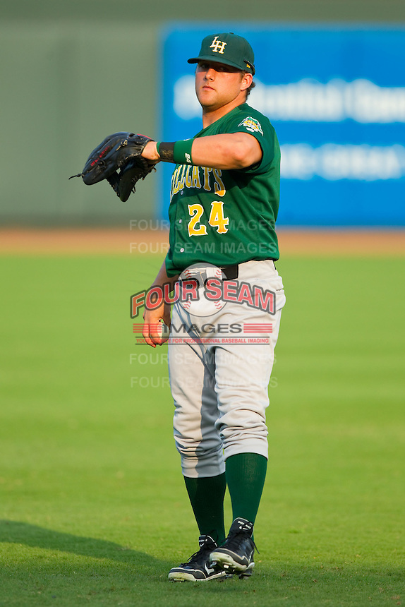 Josh Elander (24) of the Lynchburg Hillcats warms up in the outfield prior to the game against the Winston-Salem Dash at BB&T Ballpark on August 5, 2013 in Winston-Salem, North Carolina.  The Dash defeated the Hillcats 5-0.  (Brian Westerholt/Four Seam Images)