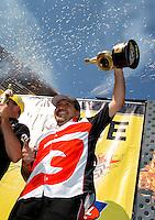 Jul. 21, 2013; Morrison, CO, USA: NHRA funny car driver Cruz Pedregon celebrates in the winner's circle after winning the Mile High Nationals at Bandimere Speedway. Mandatory Credit: Mark J. Rebilas-